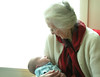 Great Grandma holds her first great grandson, on Mother's Day, 2011