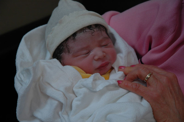 Jaden Raphael Santos Al-Aidroos, born January 3rd, 2006.  Weighing in at 8 lbs, 4 ozs soaking wet and measuring 50 cm he has already filled up both of his parents hearts.