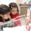 Alice and Leah meet their baby brother for the first time.