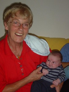 Proud grandmother  - unaware Elise is trying to steal her gold chain...