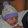 Just hours old, with a cap the nurse knitted for her!
