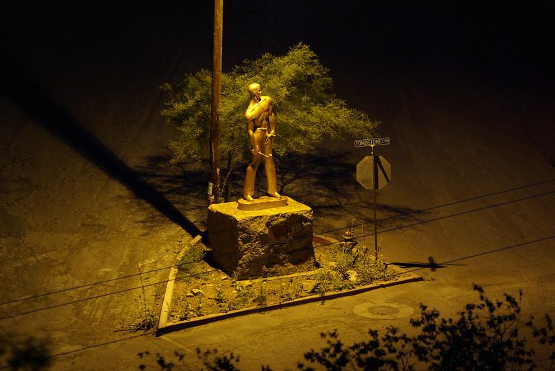 Copper Man Statue at Night
