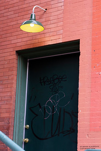 Tagged Door in Alleyway