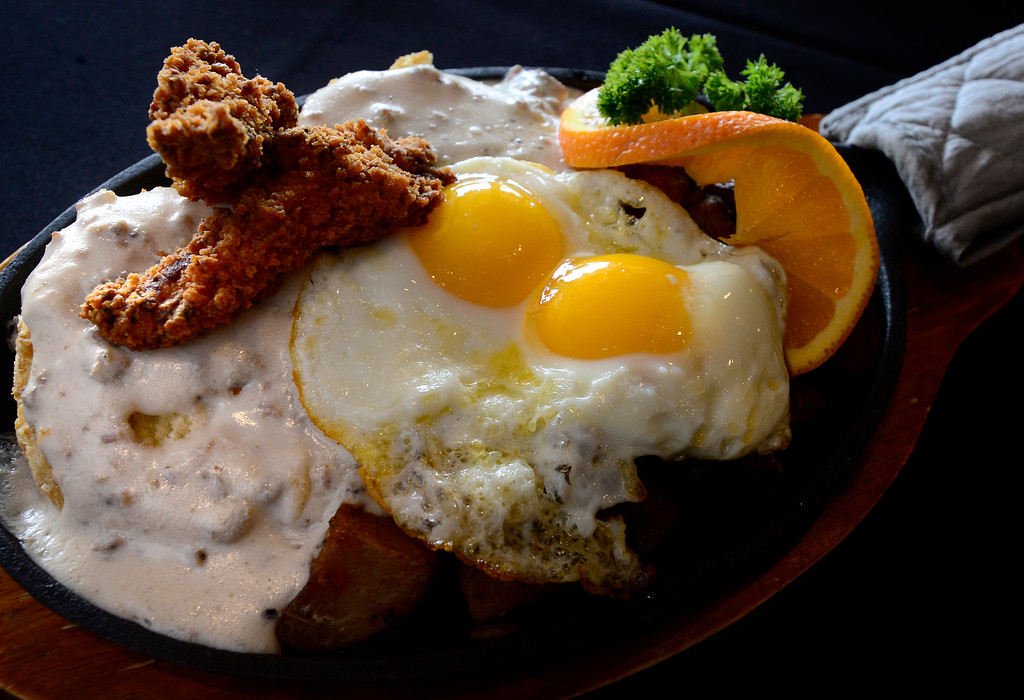 . Fried Chicken Biscuits and Gravy with over easy eggs at Biscuit Bar in Louisville on Wednesday. For more photos go to dailycamera.com  Paul Aiken Staff Photographer May 9 2018