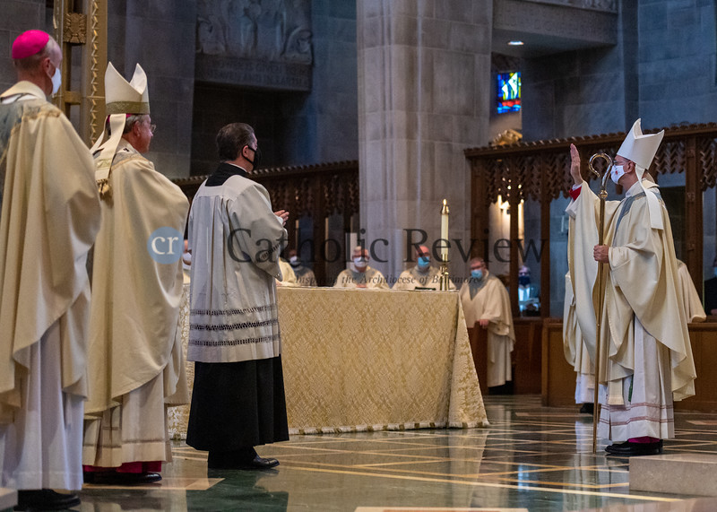 Bishop Bruce A. Lewandowski, C.Ss.R., blesses his fellow clergy and bishop during his Aug. 18 episcopal ordination at the Cathedral of Mary Our Queen in Homeland. (Kevin J. Parks/CR Staff)