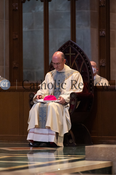 Following his Aug. 18 episcopal ordination at the Cathedral of Mary Our Queen in Homeland, Bishop Bruce A. Lewandowski, C.Ss.R.,sits in the same chair used by St. John Neumann when the Redemptorist pastor was ordained the bishop of Philadelphia at St. Alphonsus Liguori Church in Baltimore in 1852.(Kevin J. Parks/CR Staff)