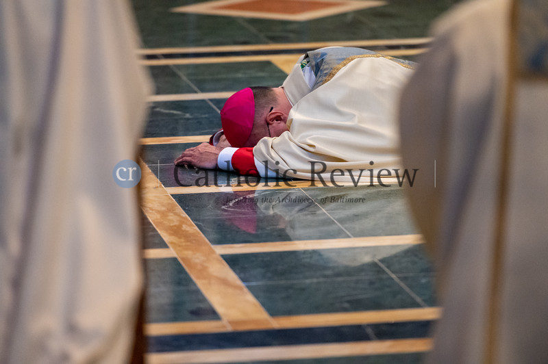 Bishop Bruce A. Lewandowski, C.Ss.R.,prostrates in the sanctuary ofthe Cathedral of Mary Our Queen in Homelandas the congregation chants the Litany of the Saints during his Aug. 18 episcopal ordination. (Kevin J. Parks/CR Staff)