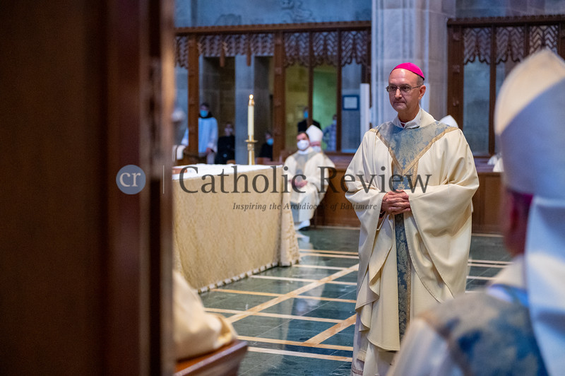 Bishop Bruce A. Lewandowski, C.Ss.R.,stands before Archbishop William E. Lori prior to his Aug. 18 episcopal ordination at the Cathedral of Mary Our Queen in Homeland(Kevin J. Parks/CR Staff)