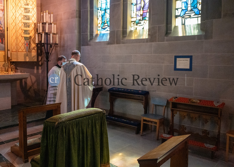 Bishop Bruce A. Lewandowski, C.Ss.R.,finds a quiet moment in one of the side chapels ofthe Cathedral of Mary Our Queen in Homelandfollowing his Aug. 18 episcopal ordination. (Kevin J. Parks/CR Staff)