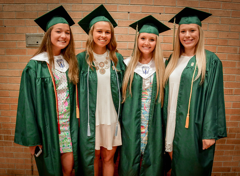 From left, Isabella Piercy of Hudson, Samantha Rheaume of Nashua, Emma Horgan of Ayer, and Emma Stalker of Hudson take a group photo before their graduation ceremony at Bishop Guertin. SUN/Caley McGuane