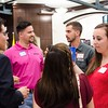 Young adult professionals gather to enjoy refreshments and network. (Photo by Adrean Indolos / NTC)