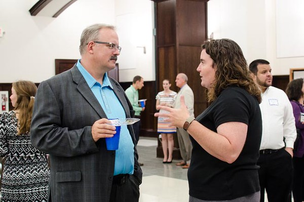 Jeff Hedglen, diocesan director of Young Adult Ministry, and Kim Brown, associate Vocations director, talk prior to Young Catholic Professionals Executive Speaker Series event. (Photo by Adrean Indolos / NTC)