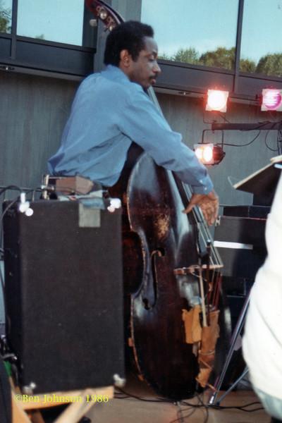 Reggie Workman  performing at The Mellon Jazz Festival in Brandywine Pennsylvania in August 1986.