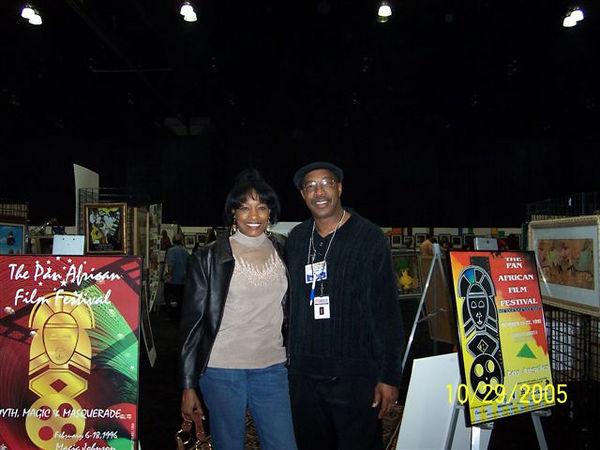 "Roscoe Lee Owens (right) and his wife Jeannette, pose at the entrance to the Pan African Art Mart at the Expo.  He is conducting a free seminar titled ""E-Wealth"" on February 11 and 18th at 3 PM in the Oasis Room, Robinson's May, during the Pan African Film Festival.  The seminar will teach wealth building through real estate.  For more information or to R.S.V.P. email roscoe@jazzzone.net."