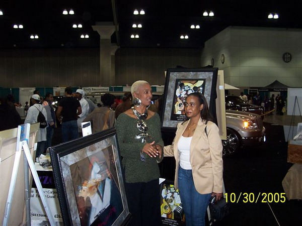 Sandra Mcdaniels gives art tour to Lana, one of the founders of the L.A. West Coast Steppers, featured at Club Hall of Fame at Hollywood Park.
