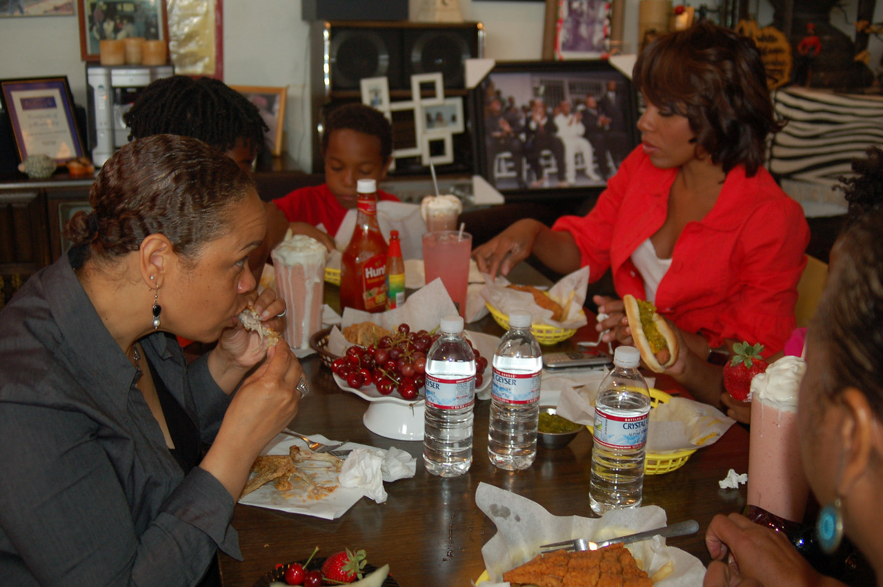 After a hard day at the photoshoot, the cast and crew grubbed at Desi's tables at the Watts Coffee House.<br /> <br /> <br /> <br /> Photo by Isidra Person-Lynn Photo © 2008 Isidra Person-Lynn