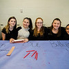 Arianna Constant, Mia Russo, Marilyn Wilson, Molly Jordan and Allison Garbriel, part of the Kids Against Mean People Youth Venture, helped students pledge to stand up against bullying during Sky View Middle School's Black Out Against Bullying day on Friday morning. SENTINEL & ENTERPRISE / Ashley Green