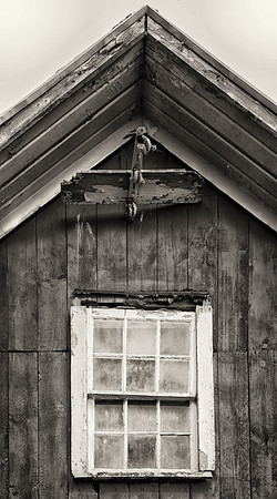 Tattered Barn Window