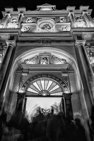 Come inside. Night open doors at the baroque cathedral of Antigua Guatemala. UNESCO World Heritage