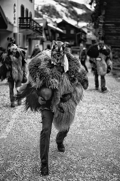 Trois Pelouches. Protectors of the village, scaring the bad spirits of winter, while the Spring shortly arrives. Ancient carnival celebtraion in Evolene, Val d'Herens, Valais, Switzerland.