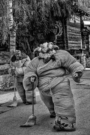 Charging Empaillé. Carnival Sunday in the Swiss Alps, with traditional straw filled suits of yute bags, sweeping away bad spirits in preparation of Spring. Evolene, Valais.