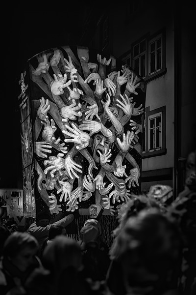 Give me a hand. Lantern during the Morgenstreich prade, early morning hours of the Basel Fastnacth. UNESCO Intangible Cultural Heritage.
