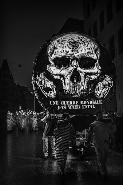 Marching Death. Lantern during the Morgestreicht parade and their Cliqué following, celebrating Fastnacht in Basel, Switzerland. UNESCO Intangible Cultural Heritage.