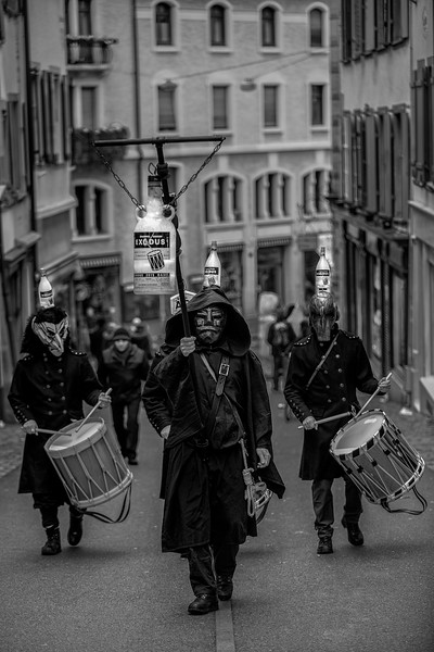 Sunrise Drummers. Last minutes of the Morgenstreicht parade in the old streets of Basel, Switzerland, celebrating Carnival. UNESCO Intangible Cultural Heritage.