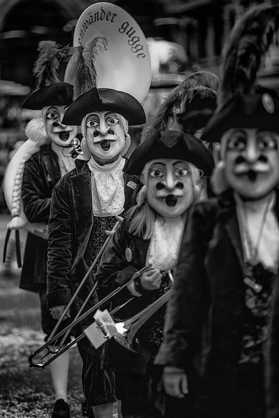 Four Stooges. Carnival Gugge, marching band, during the main parade celebrating Fastnacht in Basel, Switzerland.