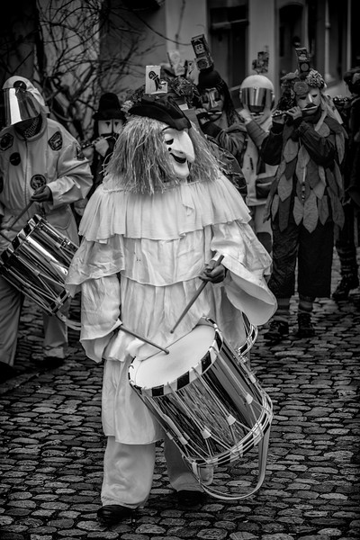 Larve Drumming. First morning hours of the Fastnach, marking the end of the Morgestreicht parade. One of the greatest Carnivals in Europe. Basel, Switzerland. UNESCO Intangible Cultural Heritage.