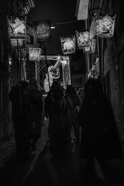 Dark Fastnacht. Lights and shadows through the old alleys of Basel, during the Morgenstreicht parade. UNESCO Intangible Cultural Heritage.