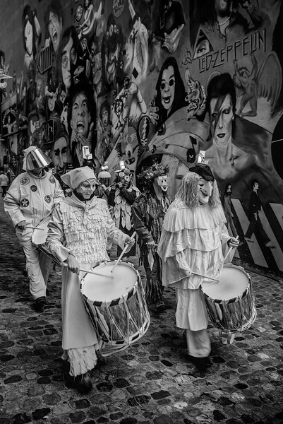 Gerbergässlein beim Fastnacht. Drummers from a carinval Clique, marching trhough the rock grafitti alley in the old city center of Basel, Switzerland. UNESCO Intangible Cultural Heritage.