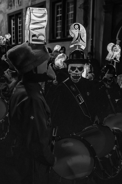Death Laughing. Clique waiting for the start of the Morgestraich, early morning hours of Carnival in Basel, Switzerland. UNESCO Intangible Cultural Heritage.