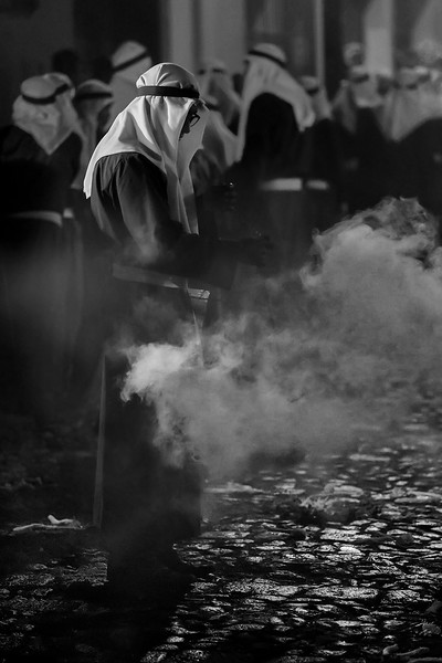 Incensario. Incense preceding the procession of Christ in Antigual Guatemala, during the holy week. Brotherhood of La Merced with the traditional palestinian penitent habit. UNESCO World Heritage.