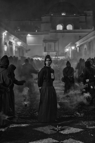 Cucurucho Antigueño. Penitents on procession in Antigua Guatemala, praying with incense to the image of Jesus Christ, celebrating the Holy Week. UNESCO World Heritage.