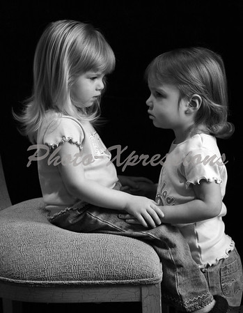 The love between two young girls (my granddaughter and great granddaughter) caught in this portrait, February 2008