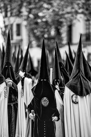 Nazarenos de Madruga. Brotherhood of the Esperanza de Triana taking the Virgin Mary in Procession on Holy Friday in Seville, Spain.
