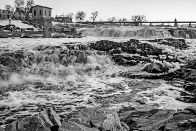 Black & white image of the falls at Falls Park in Sioux Fall, South Dakota.  Enjoy and hold hands.