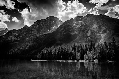 String Lake in Grand Teton National Park in the summer. In the summer, the shallow lake at the base of Grand Teton is a popular destination for kayakers, paddle boarders and swimmers.    Photo by Kyle Spradley | www.kspradleyphoto.com | © Kyle Spradley Photography String Lake in Grand Teton National Park in the summer. In the summer, the shallow lake at the base of Grand Teton is a popular destination for kayakers, paddle boarders and swimmers. The peak of Mt. Moran can be seen along the shorelines.  Photo by Kyle Spradley | www.kspradleyphoto.com | © Kyle Spradley Photography