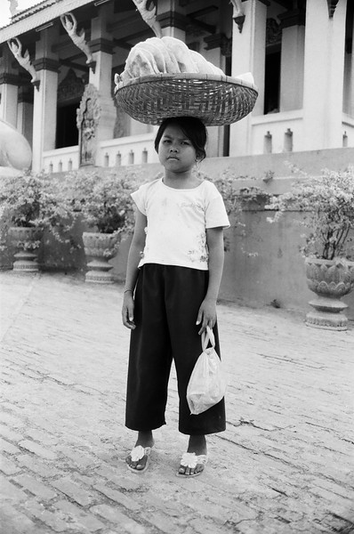 Young bread seller, Phnom Penh, Cambodia 2007