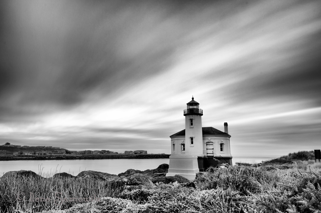 1-15-13 Coquille Lighthouse- this is a 130 sec exposure and then converted to black and whit.  I thank you all for the many comments and support of making the other Coquille Lighthouse image number one.  What a thrill especially when there were many exceptional photos posted.<br /> <br /> Critiques welcome.