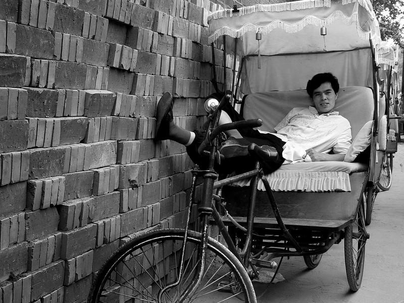 Rickshaw driver, Beijing hutongs