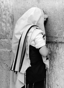 Man prays at Western Wall Jerusalem.