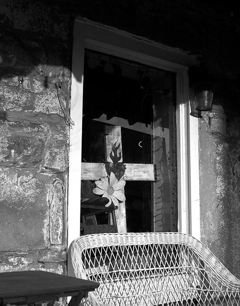 Cross in Window in Old Town Helena, Alabama shop.