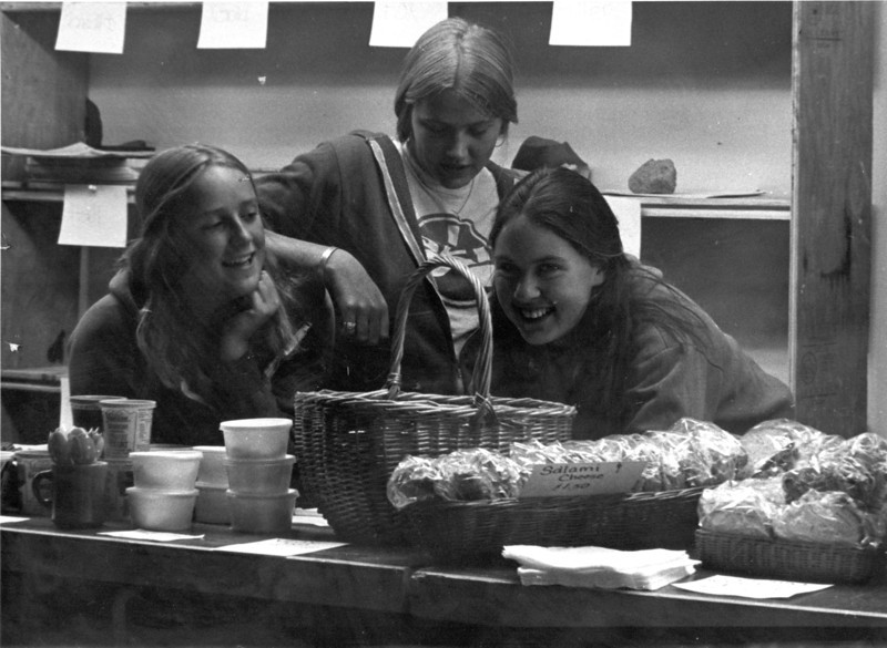 Brett Hall and sandwich girls.  1978.