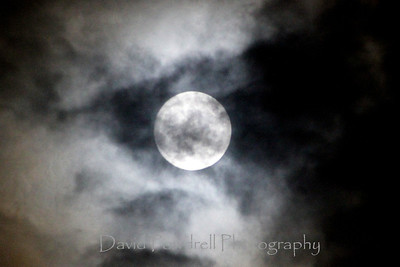 Full moon in the clouds.