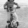 young girl riding bike Peru