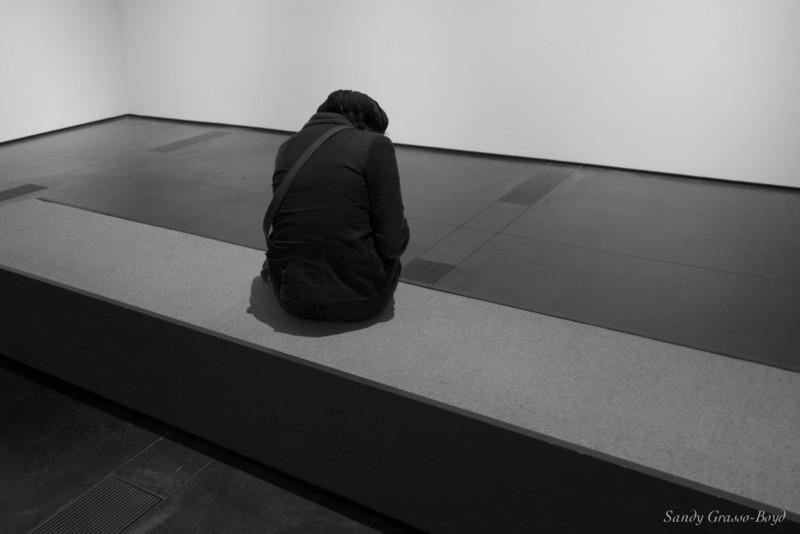 huddled figure