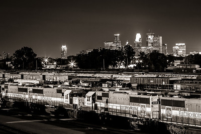 Trains, trains, and more trains - The Minneapolis skyline provides a backdrop for an almost endless supply of freight trains that rumble through the Northeast quadrant of the city every day.
