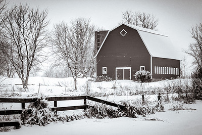 Red Barn in the snow - rendered in old-fashioned sepia tones